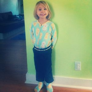 little girl wearing pants over pajamas