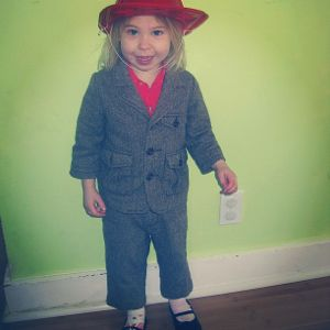 little girl wearing suit fire hat