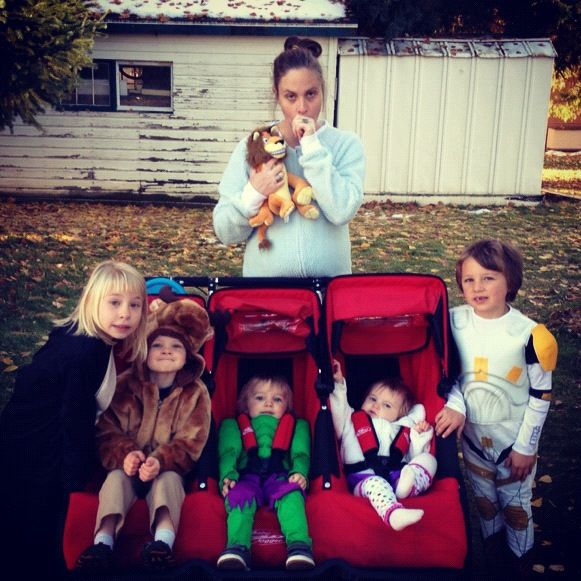 mom and kids dressed for halloween instagram