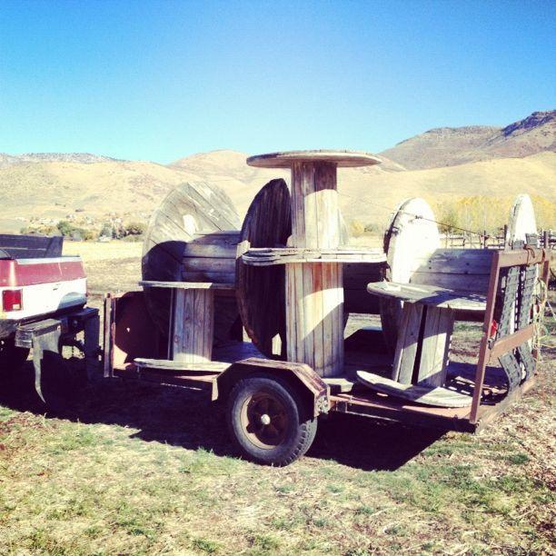 truck trailer carrying wooden spools instagram