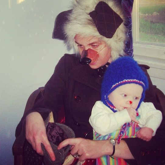woman dressed as dog baby dressed as clown instagram