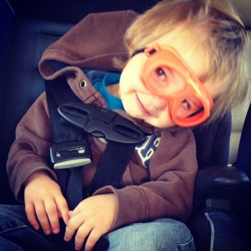 little boy car seat goggles smiling instagram