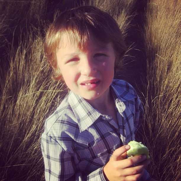 little boy eating apple instagram