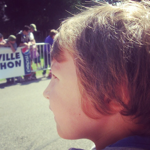 little boy finish line watching race spectator instagram