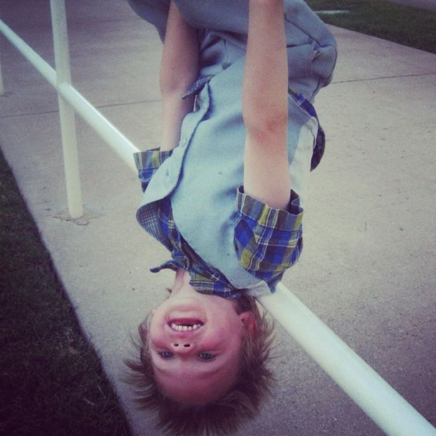 little boy hanging upside down instagram