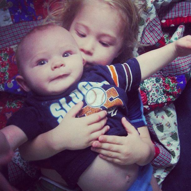 little girl holding baby instagram