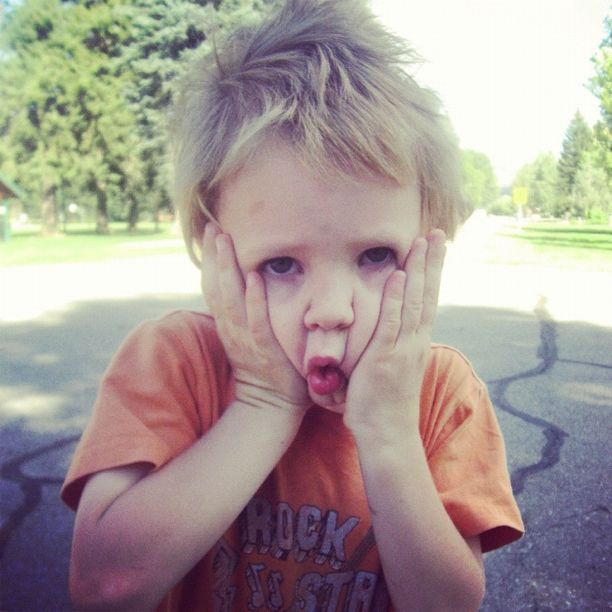 little boy squeezing cheeks making face instagram