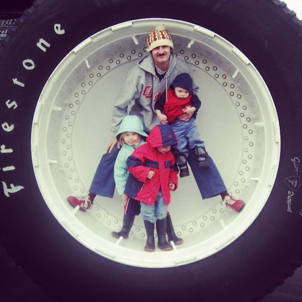 dad and kids in bigfoot monster truck wheel tire instagram
