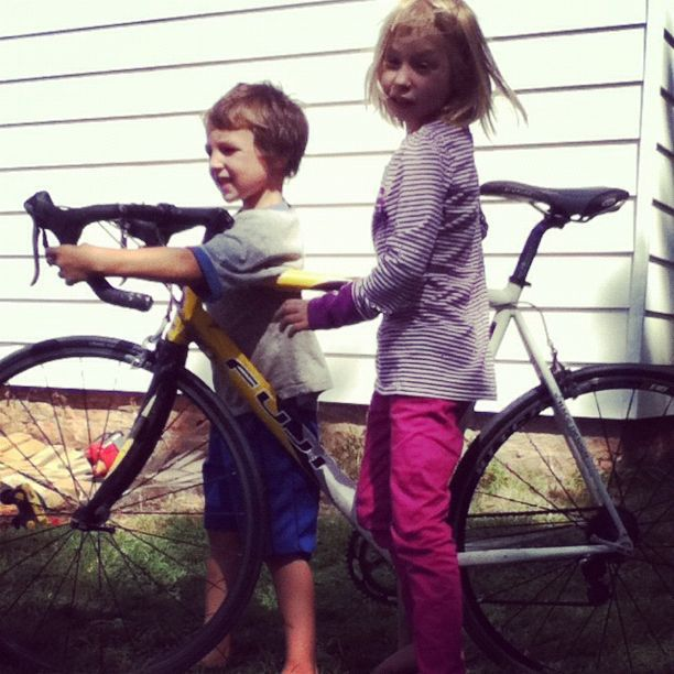 boy and girl with dad's road bike instagram