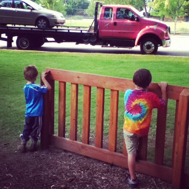 boys watching tow truck instagram