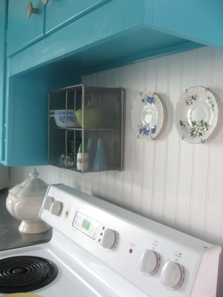 turquoise cabinets stove kitchen plates