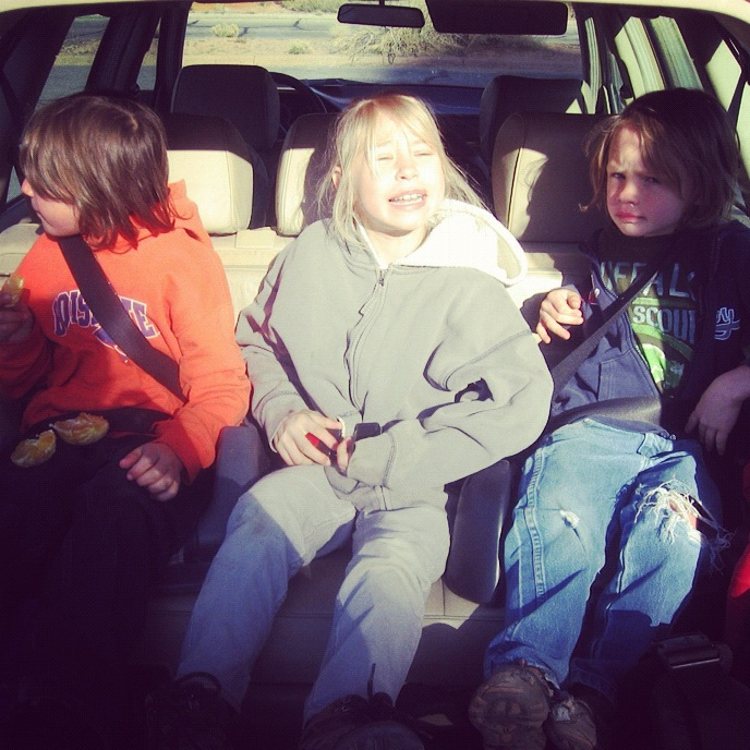kids in station wagon car arches national park moab instagram