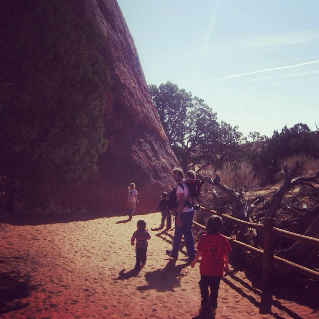 family hiking arches national park pine tree arch moab instagram