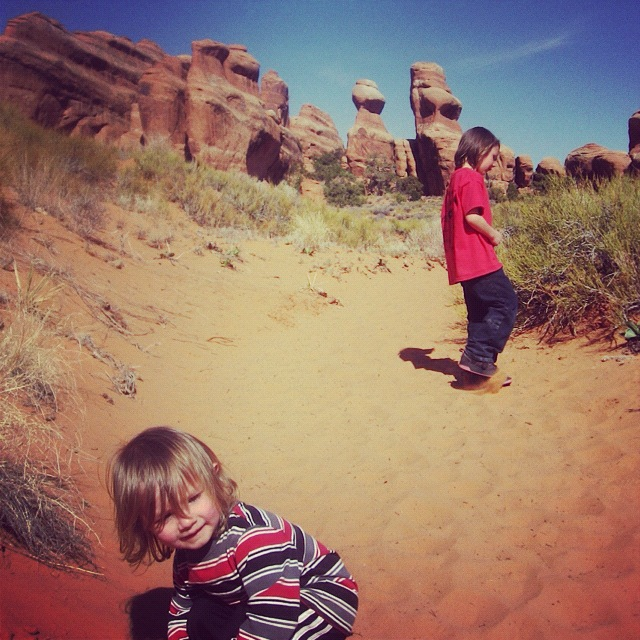 little boys hiking arches national park moab instagram