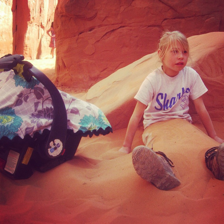 little girl car seat arches national park moab sand dune arch instagram