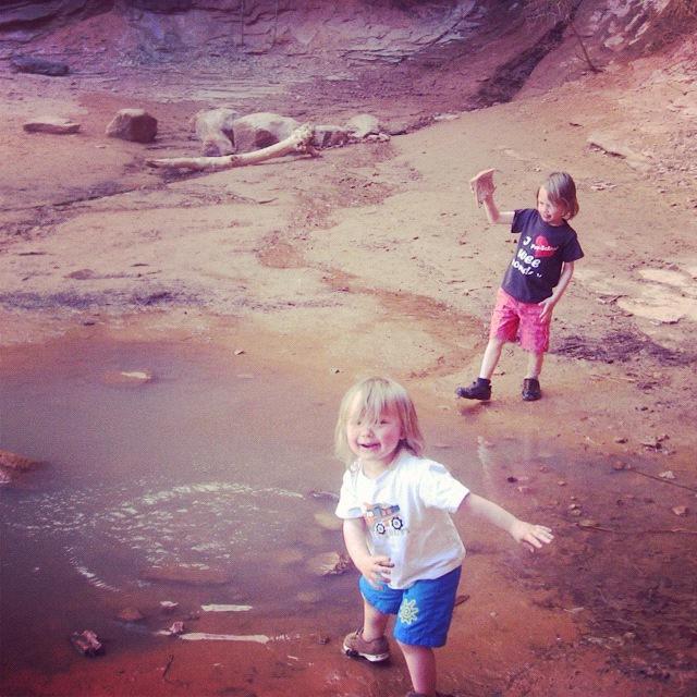 little boys throwing rocks moab negro bill canyon instagram