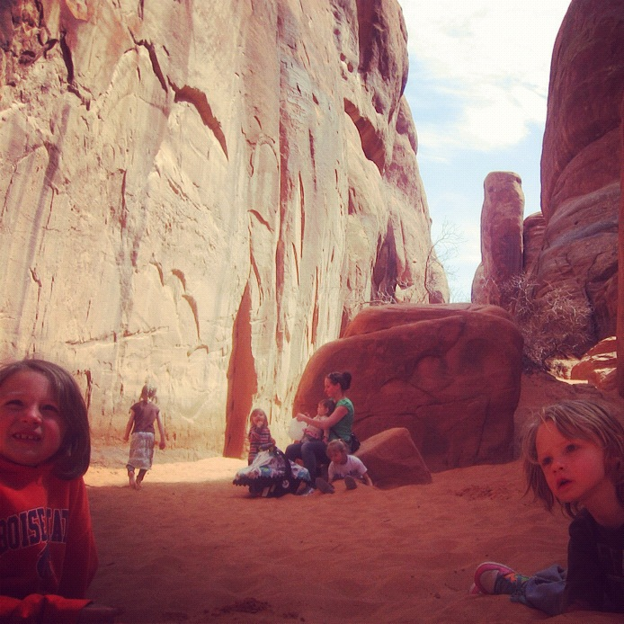family hiking arches national park moab sand dune arch instagram