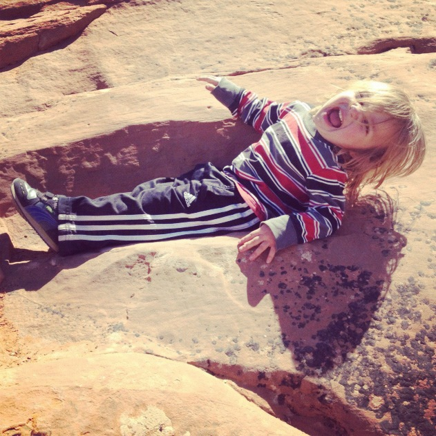 little boy hiking arches national park moab instagram