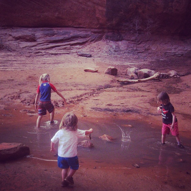 little boys throwing rocks moab negro bill canyon instagram