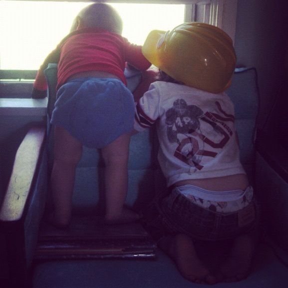 little boys leaning looking out window instagram