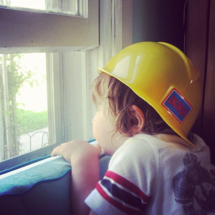 little boy looking out window hard hat instagram