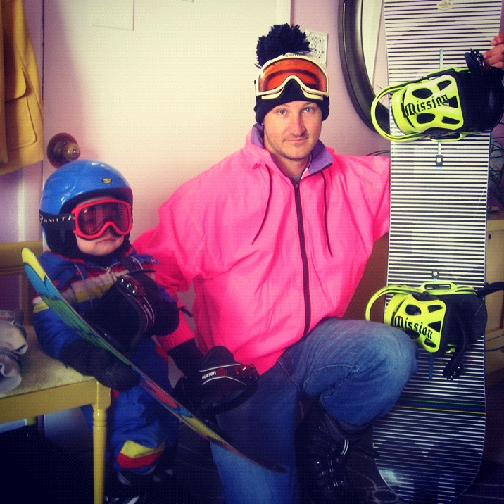 man and little boy son father snowboarding fluorescent pink 80s instagram