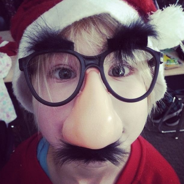 little girl santa hat false nose glasses instagram