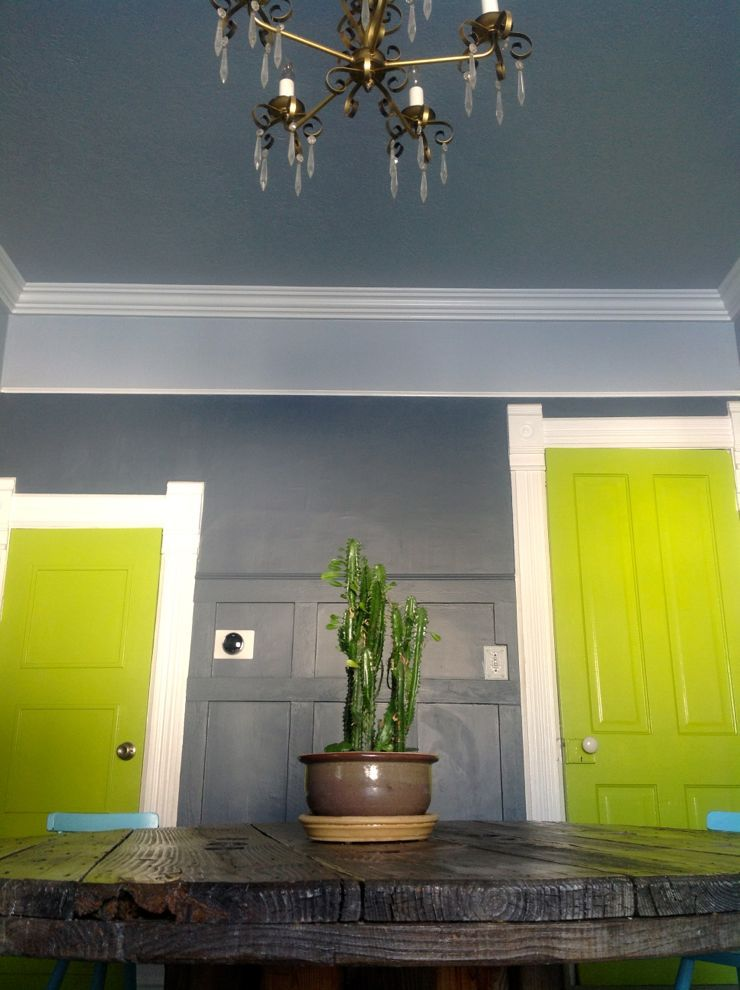 wooden spool dining table room grey wainscoting chartreuse doors