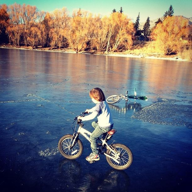 little boy riding bike on ice instagram