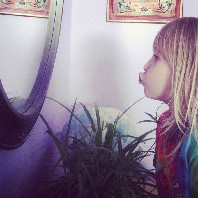 little girl looking in mirror instagram