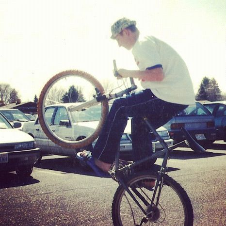 boy wheelie parking lot 90s instagram
