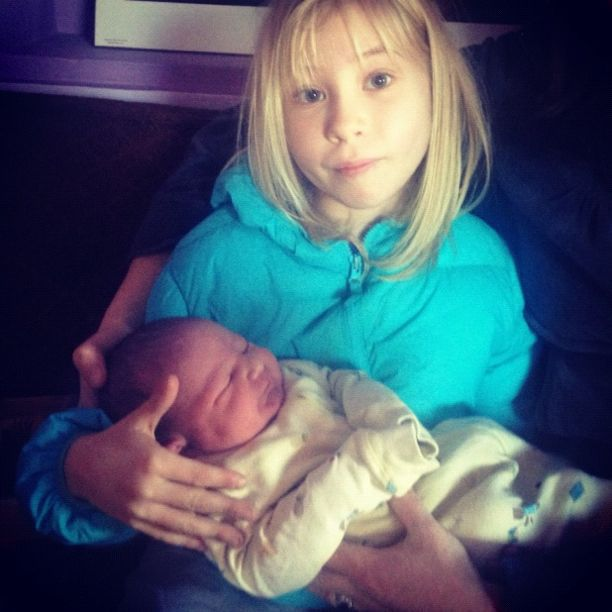 little girl holding newborn baby brother boy instagram
