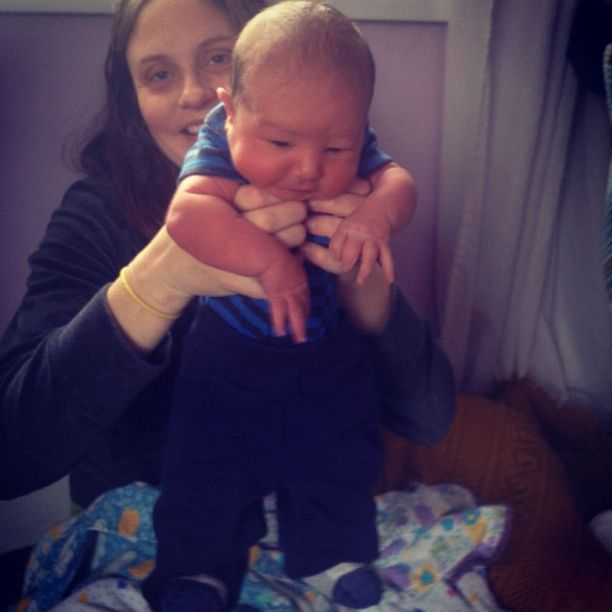 mom holding newborn baby boy instagram