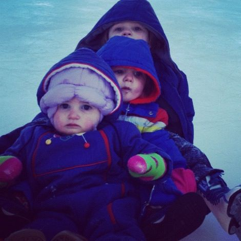 kids on a sled outside ice rink instagram
