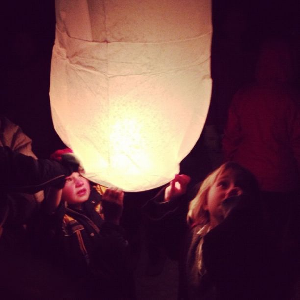kids lighting paper lanterns instagram