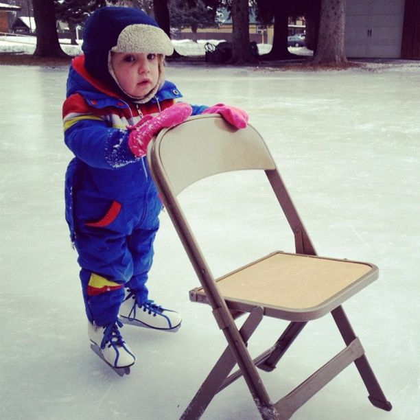 little boy learning to ice skate with chair and double blade skates instagram