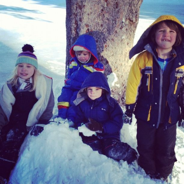 kids sitting in snow instagram