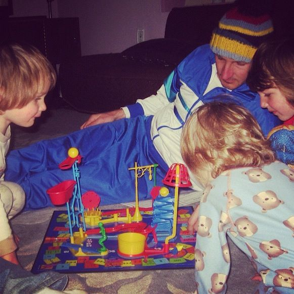 dad and kids playing board game mouse trap instagram