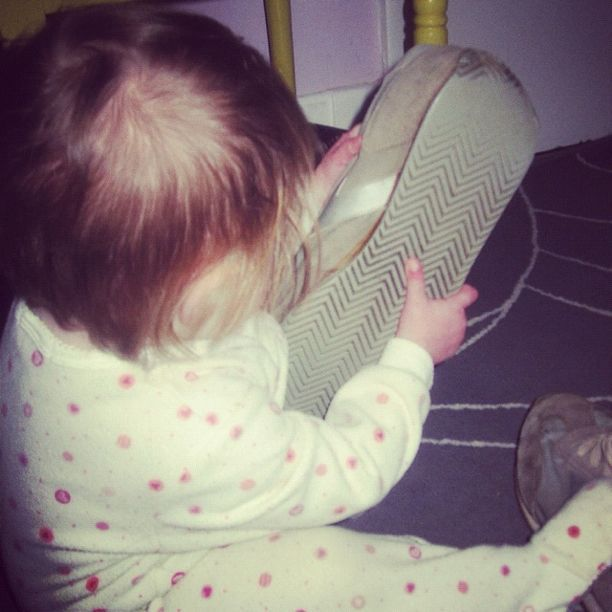 baby girl putting on dads shoes instagram