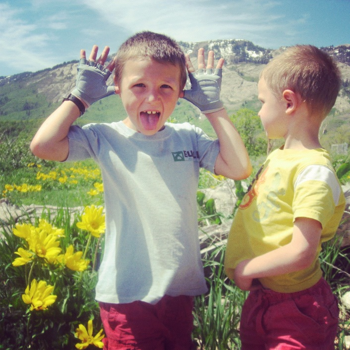 brothers hugging mountain instagram