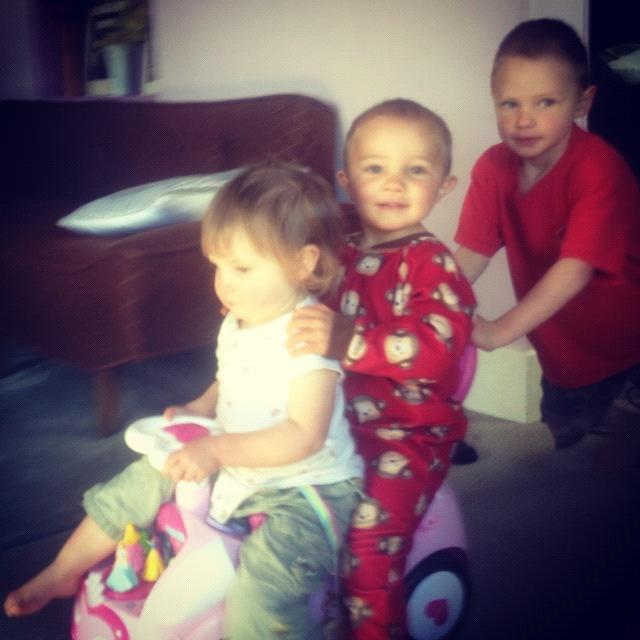 three kids on a toy car instagram