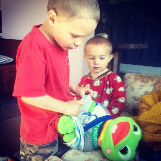 little boy putting underwear on stuffed animal instagram
