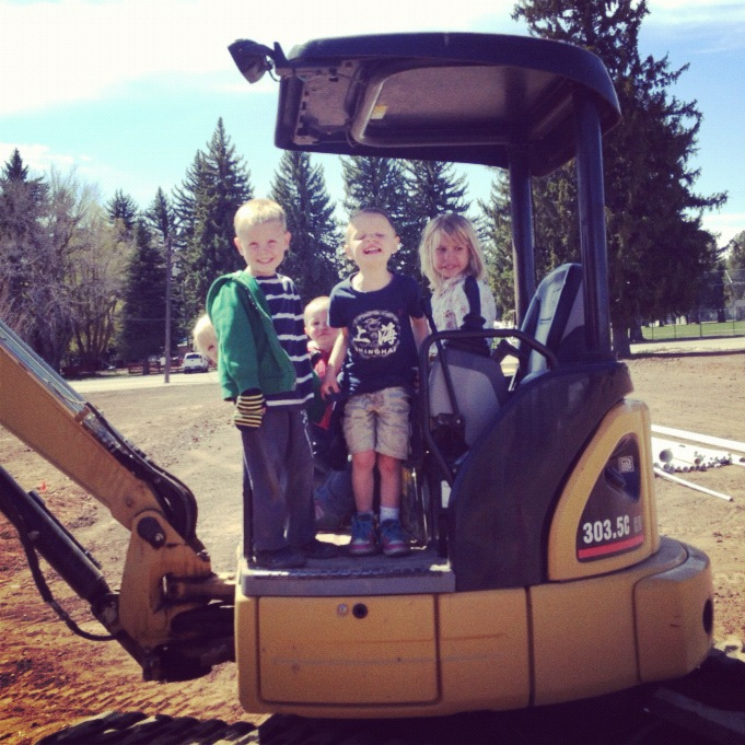 kids standing on backhoe instagram