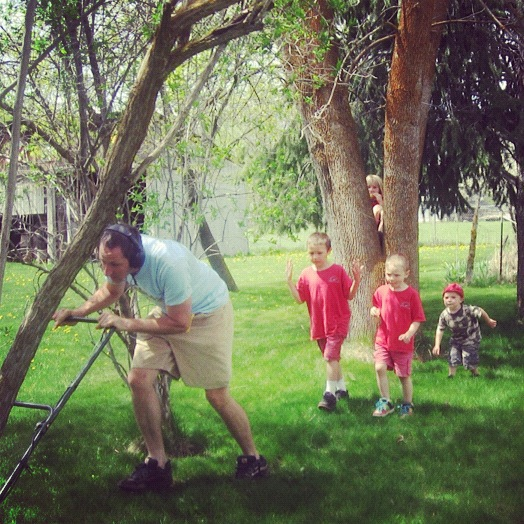 boys following dad mowing lawn instagram
