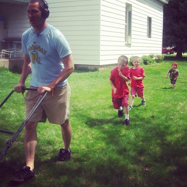 boys following dad mowing lawn instagram