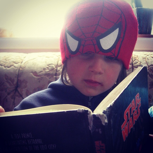 little boy reading book star wars spiderman hat instagram