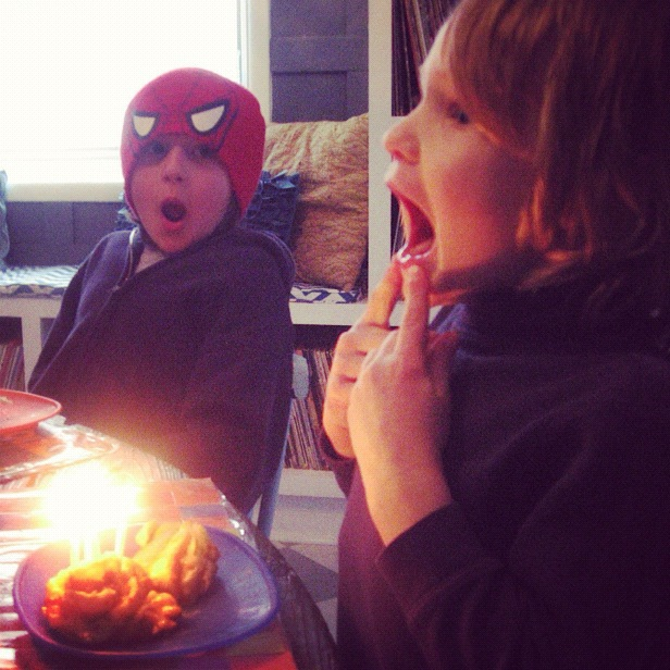 little boy blowing out candles birthday instagram