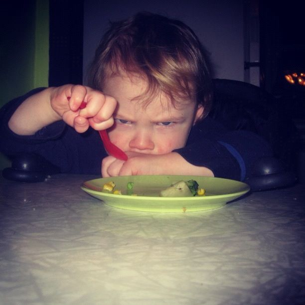 little boy glare eating vegetables instagram