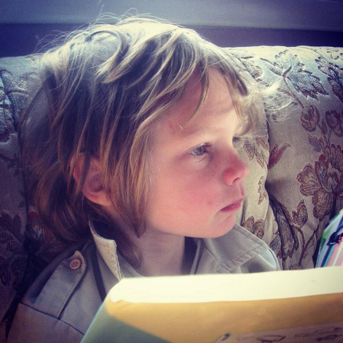 little boy reading book instagram