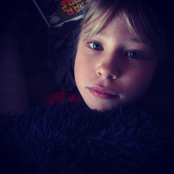 little girl reading instagram